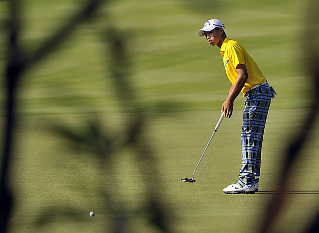 Guan Tianlang, 14, leads the Asia-Pacific Amateur by two heading into Sunday. (AP)