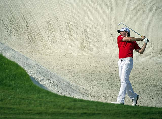 McIlroy overcomes early woes in Dubai to win the European Tour finale. (AP)