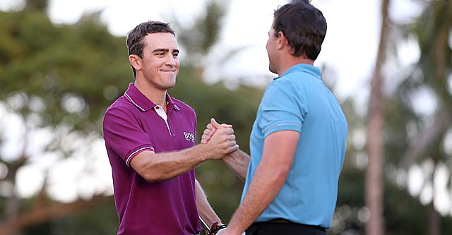 Scott Langley (left) earns hearty congratulations from Luke Guthrie after his eye-opening 62. (Getty Images)