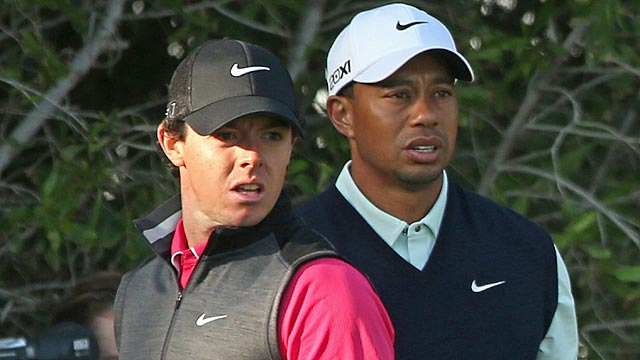 Rory McIlroy and Tiger Woods spend most of the round making faces at their wayward shots. (Getty Images)