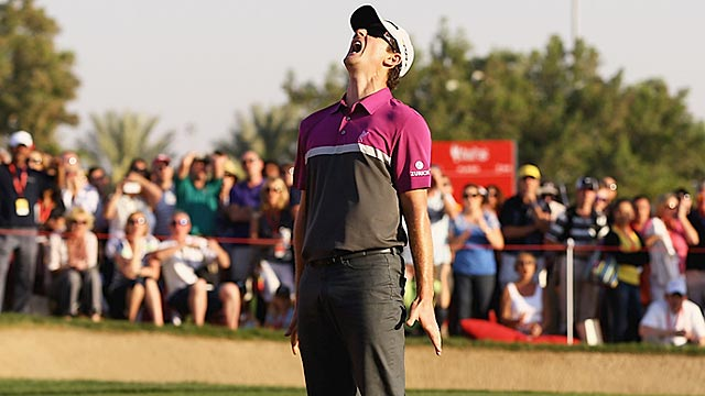 Justin Rose reacts after seeing his potential playoff-forcing putt lip out. (Getty Images)