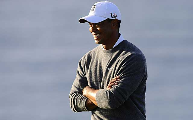Tiger Woods has reason to smile, leading the suspended Farmers Insurance Open by six strokes. (US Presswire)