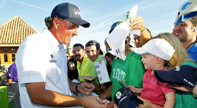 Phil Mickelson puts on a show for the biggest crowd in golf history Saturday. (Getty Images)