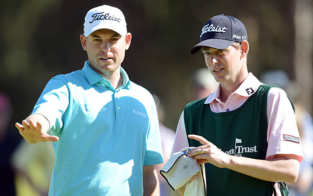 Bill Haas consults with caddie/older brother Jay Haas Jr. during the third round. (Getty Images)