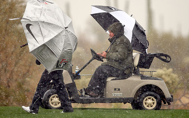 Snow, sleet and rain sent players, officials and fans scurrying for cover at Dove Mountain. (Getty Images)