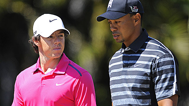 While Rory McIlroy fails to break par, Tiger shoots 6-under 66 for a five-way tie for the lead. (Getty Images)