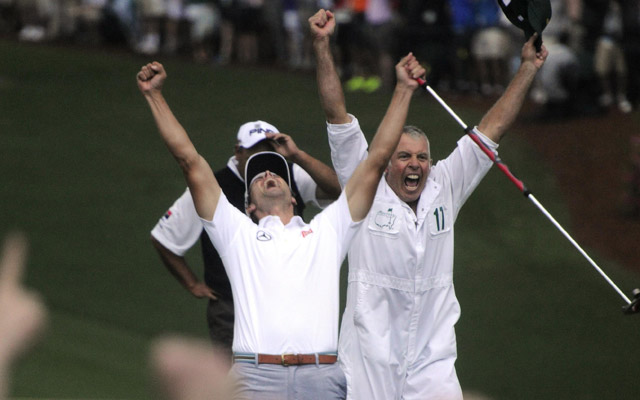Adam Scott and caddie Steve Williams celebrate his championship-winning birdie putt at the 77th Masters. (USATSI)