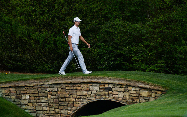 Adam Scott walks across a bridge during his final round. (USATSI)