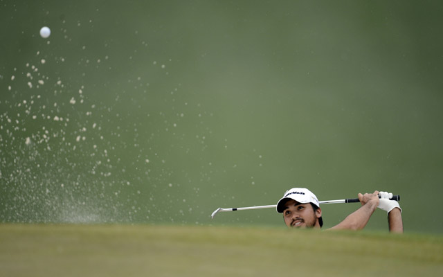 Jason Day hits out of a bunker. (USATSI)