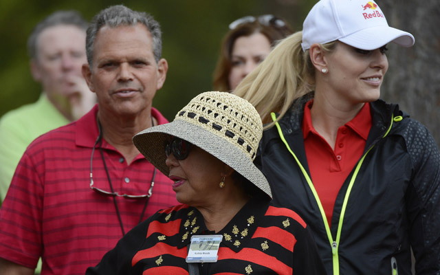 From left to right, Tiger Woods' agent, Leigh Steinberg, Tiger's mom, Kultila Woods, and Tiger's girlfriend, Lindsey Vonn, all wear red in support.  (USATSI)