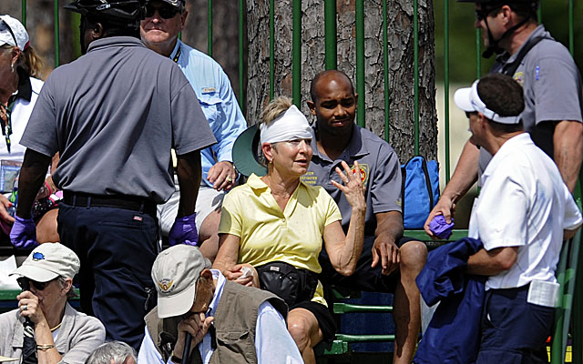 A woman was treated by EMS workers after being hit by Marc Leishman's shot from the rough on No. 9. (AP)