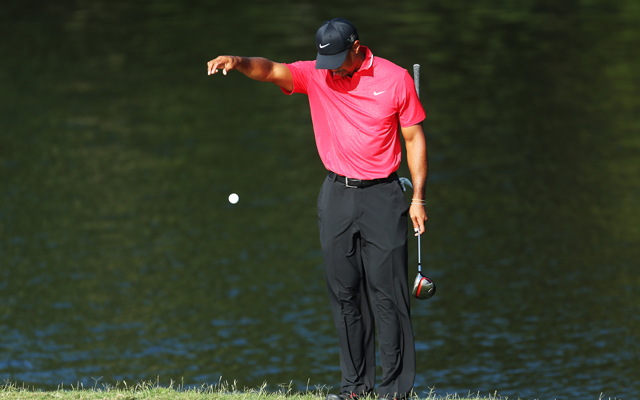 Tiger Woods makes a drop on Sunday at the Players Championship (Getty Images)