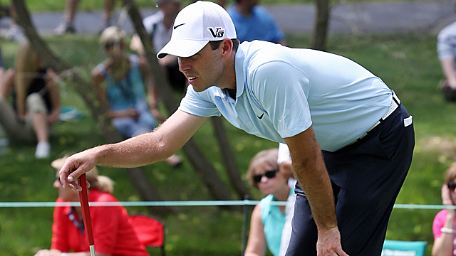 Charl Schwartzel lines up a putt at the Memorial. (USATSI)