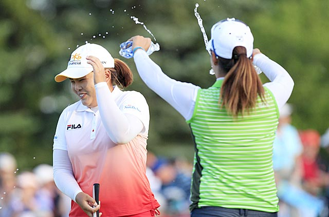 Back-to-back majors winner Inbee Park gets a celebratory dousing from fellow Korean golfer Chella Choi. (USATSI)