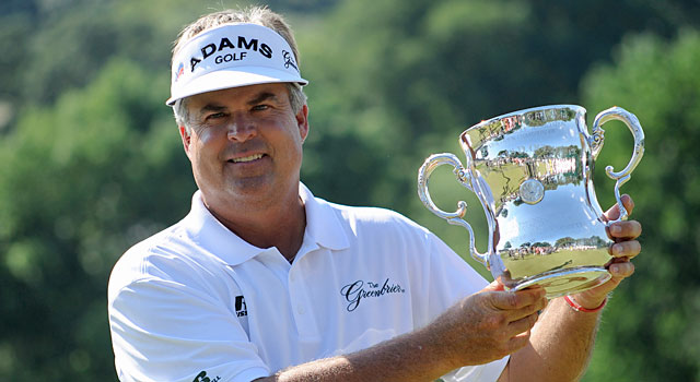 Kenny Perry hoists his hardware after a five-shot win at the Senior Open. (USATSI)