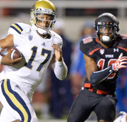 UCLA's Brett Hundley scores three touchdowns throwing, catching and rushing to lead the Bruins to a big road win in Utah.  (USATSI)