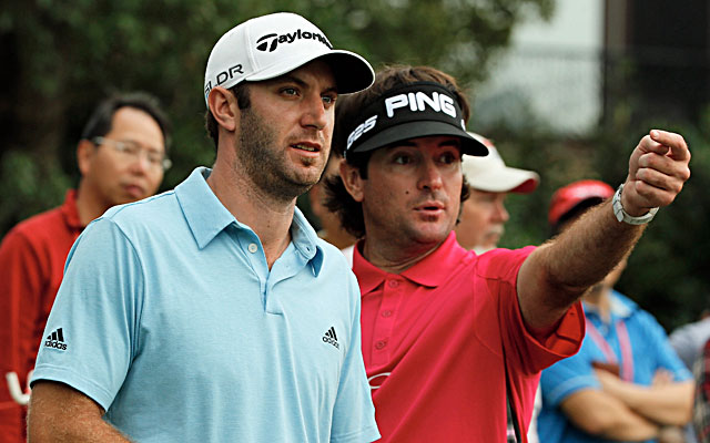 Dustin Johnson (left) and Bubba Watson try to determine where Johnson's tee shot landed. (Getty Images)
