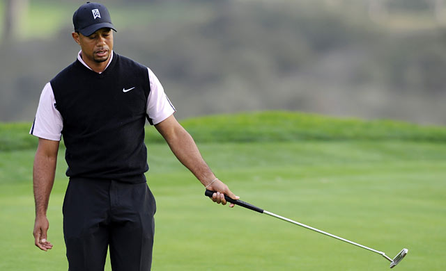 Tiger reacts to missing a birdie putt on the 16th. (USATSI)
