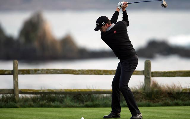 Jimmy Walker braves the elements with a bogey-free round at Spyglass Hill. (Getty Images)