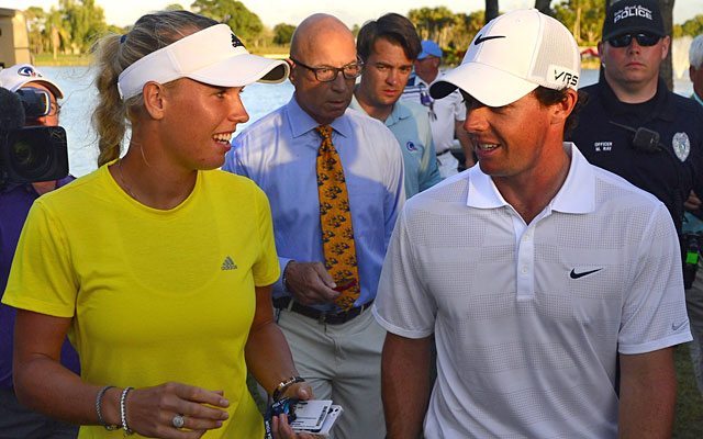 Rory McIlroy heads to the clubhouse with girlfriend Caroline Wozniacki after his third round. (USATSI)