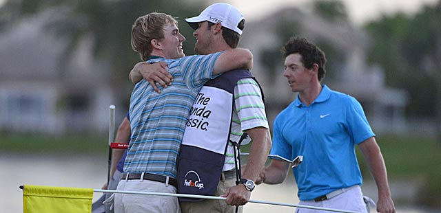 Russell Henley bests Rory McIlroy and two others in a playoff to win in South Florida.