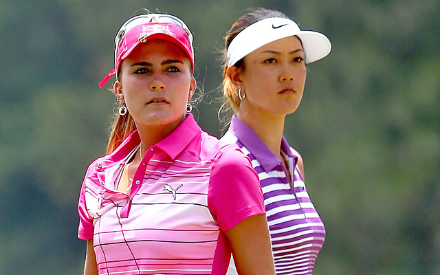 While playing partner Lexi Thompson fades with a 74, Michelle Wie stays atop the leaderboard. (Getty Images)