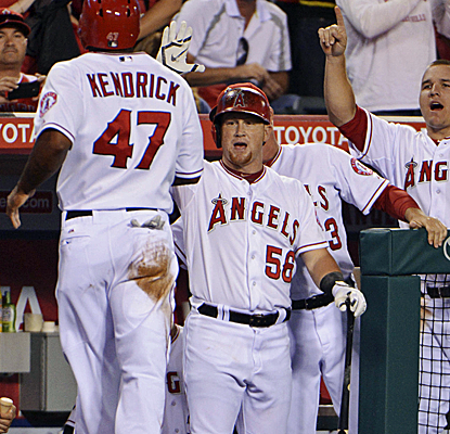 After the A's win on a walk-off homer, the Angels keep pace with a 16-inning victory over the Mariners.  (USATSI)