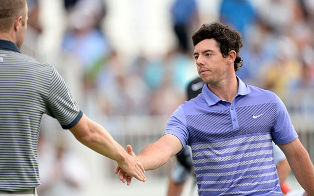 Rory McIlroy shakes hands with FedEx Cup leader Chris Kirk after their round. (USATSI)