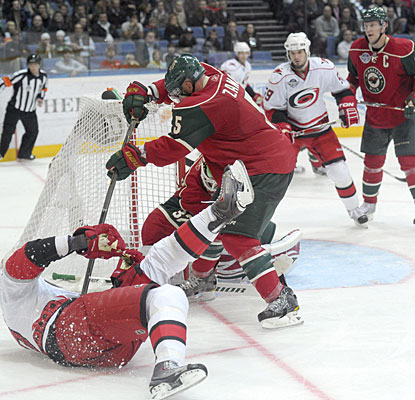 Hurricanes captain Eric Staal is taken down as he attempts to score from a tough position. (Getty Images)
