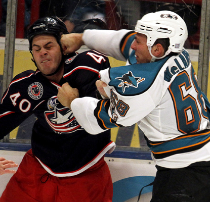 The Blue Jackets' Jared Boll fights with the Sharks' Frazer McLaren during a scrappy game in Stockholm, Sweden.  (AP)