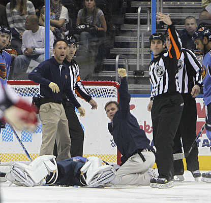 Game officials and medical personnel quickly signal for a stretcher to be brought to the ice for Ondrej Pavelec. (AP)