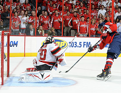 Alex Ovechkin scores on Martin Brodeur for his second penalty shot conversion in seven career attempts. (Getty Images)