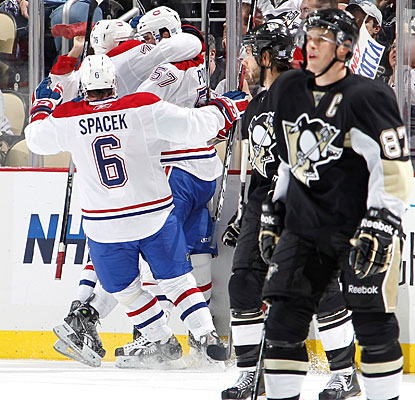 While Sidney Crosby (87) skates away dejected, the Canadiens celebrate one of Mike Cammalleri's two goals. (Getty Images)