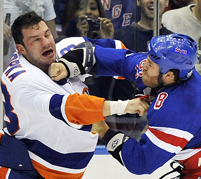 Rangers-Isles games are usually nasty, and it's no different this time as Brandon Prust (8) fights Zenon Konopka (28). (AP)