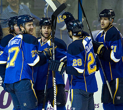 Andy McDonald (center) enjoys his goal just six seconds after teammate David Backes tallies for the Blues. (US Presswire)