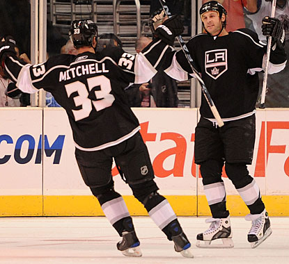 Ryan Smyth (right) scores the first goal for L.A., sets up the second and puts the game away with an empty netter. (Getty Images)