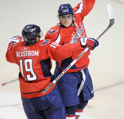 The Capitals' left wing, Alex Ovechkin (right), celebrates his goal with teammate Nicklas Backstrom.  (US Presswire)