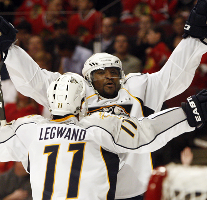 The Predators' Joel Ward (right) celebrates after scoring the game-winning goal.  (AP)