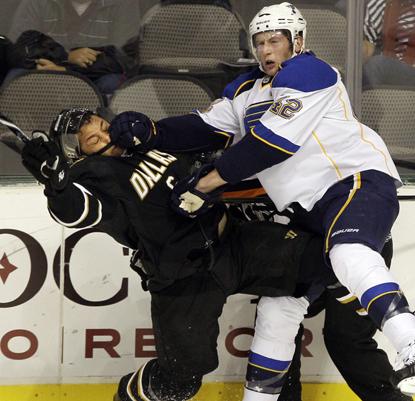 The Blues' David Backes knocks Trevor Daley into the boards.  (AP)