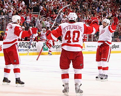 After practically playing the entire OT on the power play, Niklas Kronwall (right) tallies the winner. (Getty Images)