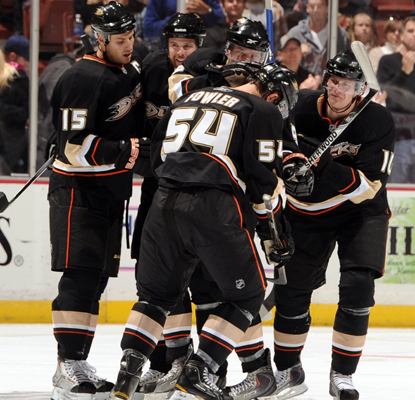 The Ducks' Cam Fowler (54) celebrates his first NHL goal with his teammates.  (Getty Images)