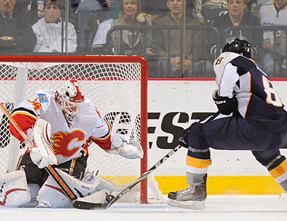 Miikka Kiprusoff makes a point-blank save, one of 34 stops for his 35th career shutout in the NHL.  (Getty Images)