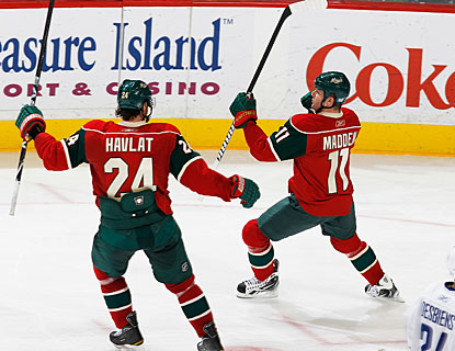 John Madden (11) nets an even-strength goal in the second period for the high-scoring Wild.  (AP)