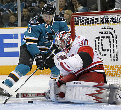 Cam Ward closes down to prevent Joe Pavelski from a quality scoring opportunity in front of the net (AP)
