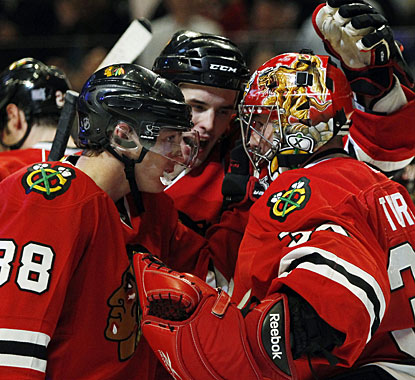 Patrick Kane (88) and Niklas Hjalmarsson react to a fine effort by Marty Turco in net in the shootout. (AP)