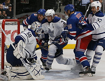 In a crowded crease, Ruslan Fedotenko pushes the puck past Leafs goalie Jonas Gustavsson for his first goal as a Ranger. (Getty Images)