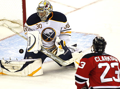 Unlike his counterparts on the night, Ryan Miller has a good game with 26 saves for Buffalo. (AP)