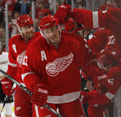 Detroit's Pavel Datsyuk celebrates with his team after scoring the winning goal against the Ducks. (US Presswire)