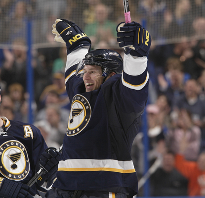 The Blues' Erik Johnson celebrates his game-winning goal in overtime against the Penguins.  (Getty Images)