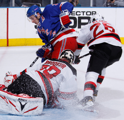 The Rangers' Ryan Callahan scores a crucial goal against the Devils' Martin Brodeur that helps lead New York to victory.  (Getty Images)